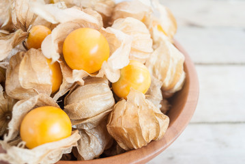 Cape gooseberry (Physalis) in wooden bowls