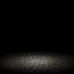 illuminated stone floor on a black background