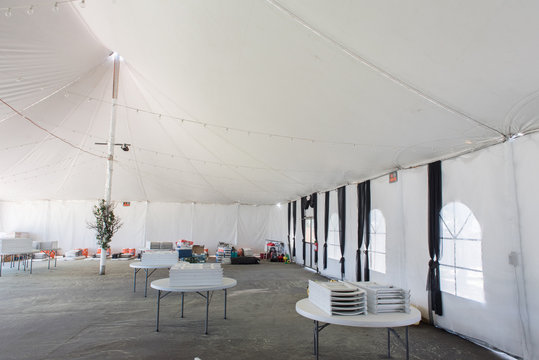 Inside a large white tent for entertaining