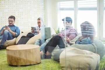 Creative business people using technologies
