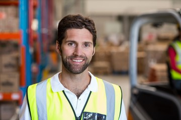 Portrait of happy worker is posing face to the camera