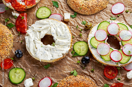 ... : Delicious Bagel sandwiches with soft cheese, chorizo and vegetables