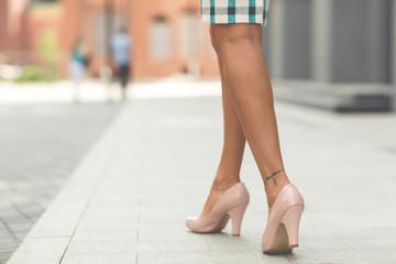 legs of a beautiful girl in high heels