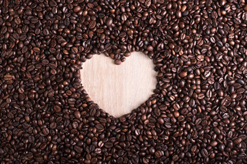 Roasted coffee beans with hearth shape