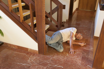 Senior man fell down the stairs onto marble floor