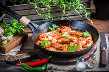Tasty shrimps with garlic and red peppers