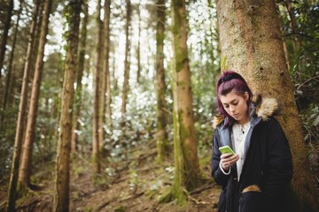 front view of woman using her smartphone