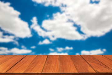 Wood table top on sky background