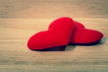 Valentine day background, red love heart on wooden background