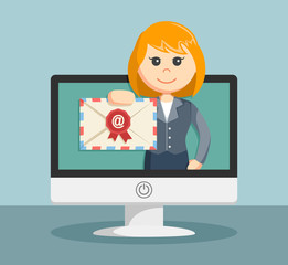 businesswoman shows on the monitor email to its customers