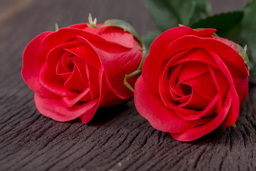 Valentine day with red rose on wood table