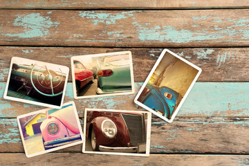 Classic car photo album on wood table. instant photo of retro camera - vintage styles
