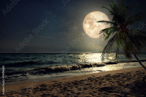 Wall mural Beautiful fantasy tropical beach with Milky Way star in night skies, full moon - Retro style artwork with vintage color tone (Elements of this moon image furnished by NASA)