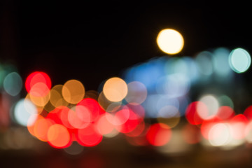 image of blur street bokeh with colorful lights in night time.