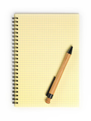 Yellow notebook with bamboo pen