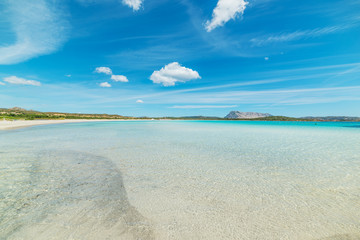 soft clouds over Lu Impostu beach Fototapete