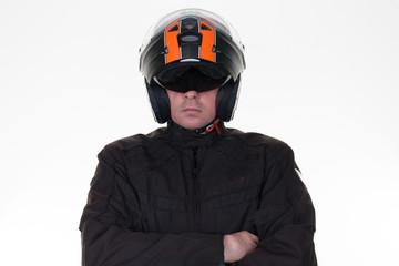 Macho motorcycle rider posing while wearing his jacket,