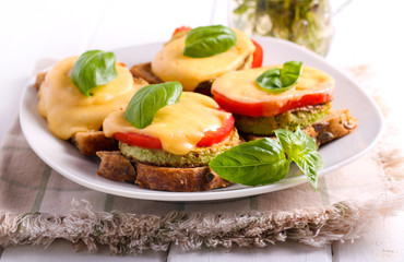 Zucchini, tomato and cheese appetizer