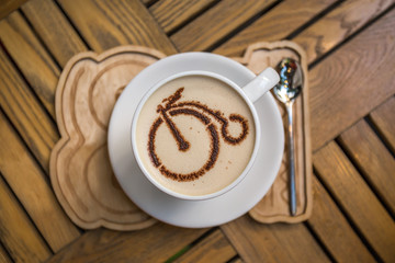 Сup of coffee with bicycle picture