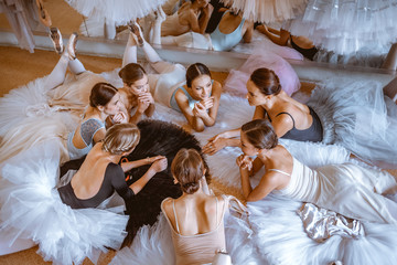 The seven ballerinas against ballet bar