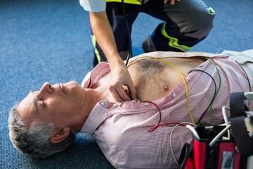 Paramedic examining a patient