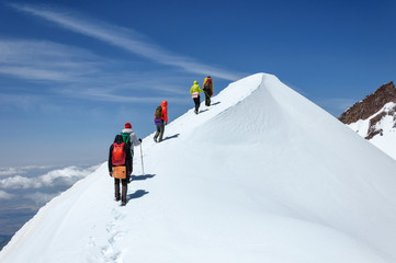 Group climbers goes down from the top of Erciyes volcano. Wall mural