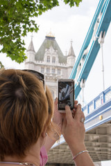 Woman shooting to the Tower Bridge