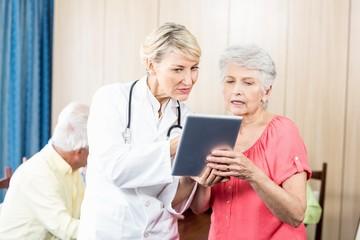 Nurse talking to a senior woman