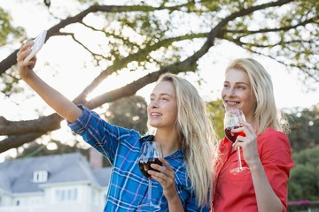 Beautiful women taking a selfie from mobile phone