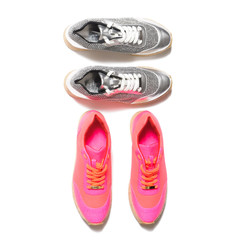 Two pair of sneakers pink & grey isolated on white background