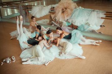 The seven ballerinas against ballet bar