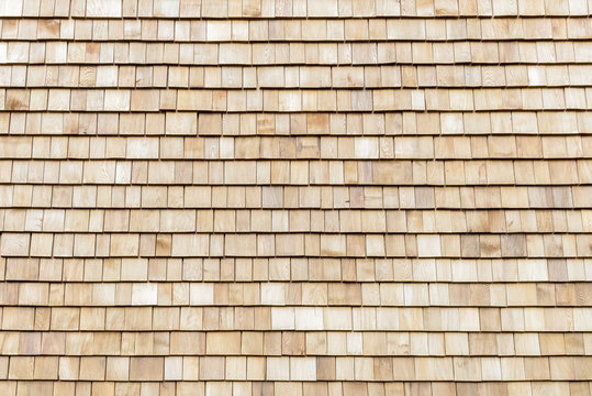 Several wood cedar shingles for siding or roofs.