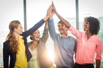 Business people giving high five to each other