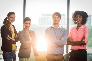 Portrait of business people standing with arms crossed