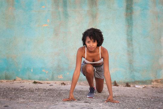 Woman crouching to start running