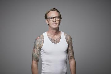 Portrait of tattooed man wearing vest