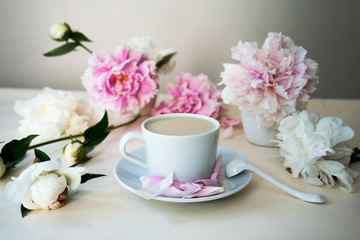 cappuccino and fresh peonies, still life