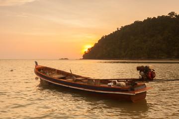 Beautiful sunset with little boat at  Payam Island ,Thailand