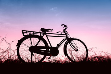 beautiful landscape image with Silhouette  Bicycle at sunset in