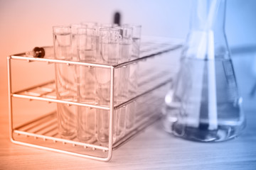Glass laboratory chemical test tubes with liquid. Selective focu
