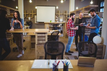 Business people talking during coffee break