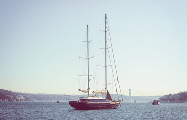 Istanbul, Turkey - March 18, 2012: Yacht out in the coastal zone of the Marmara sea on a bright sunny summer holiday, People travelling by yachts see Bosphorus