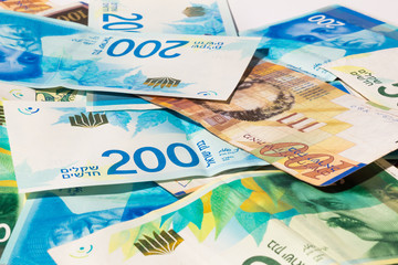 Stack of various of israeli shekel money bills