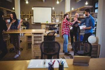 Business people during coffee break in office