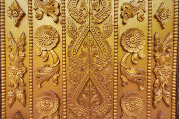 Wood carving on the wall in Myanmar. Myanmar carving on golden wall.