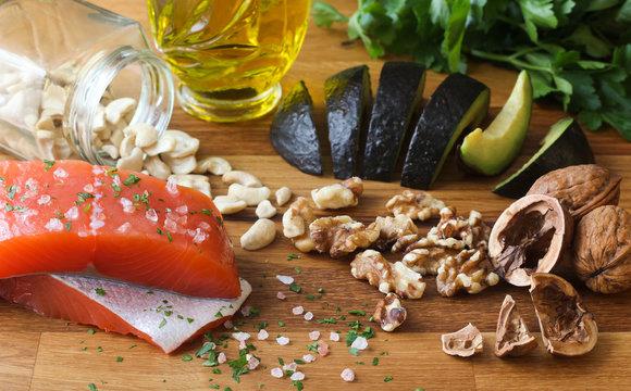 Omega 3 healthy fats food salmon avocado on butchers block