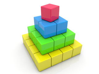 Toy cubes assembled in pyramid on white
