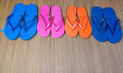 flip-flop sandals on grunge sackcloth