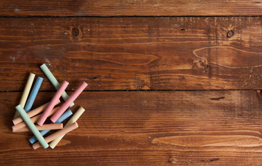 Still life, education concept. Pieces of chalk on a wooden backg