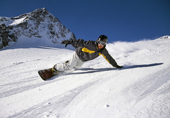 Person snowboarding down mountain